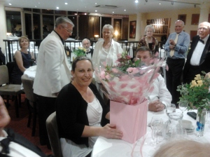 Sue Court presented with flowers